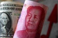 人民币跌势料减缓,短期内汇率不太可能破7